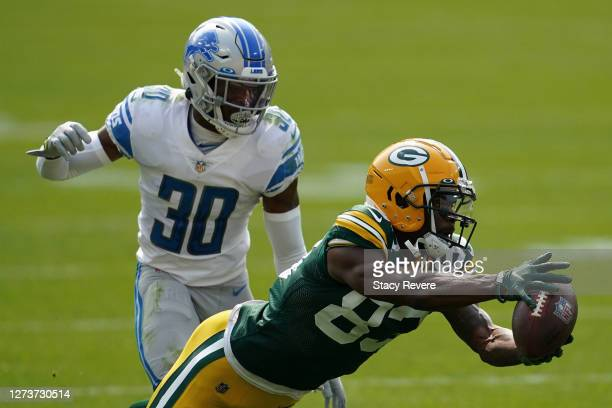 Marquez Valdes-Scantling of the Green Bay Packers is unable to catch a pass in front of Jeff Okudah of the Detroit Lions at Lambeau Field on...
