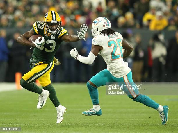 Marquez ValdesScantling of the Green Bay Packers runs against Bobby McCain of the Miami Dolphins during the first half of a game at Lambeau Field on...