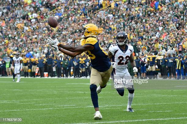 Marquez ValdesScantling of the Green Bay Packers scores a touchdown in the first quarter against Kareem Jackson of the Denver Broncos at Lambeau...