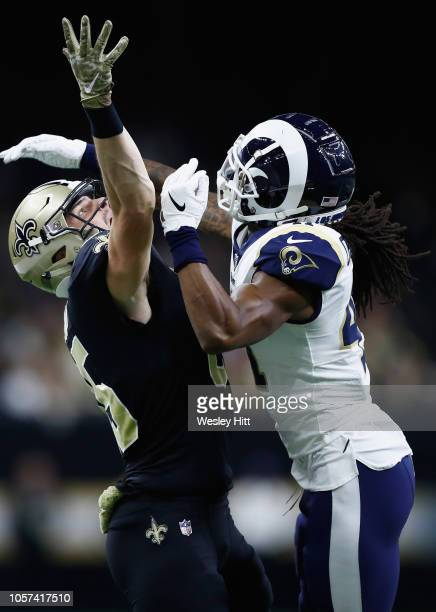 Marqui Christian of the Los Angeles Rams breaks up a pass meant for Josh Hill of the New Orleans Saints during the fourth quarter of the game at...
