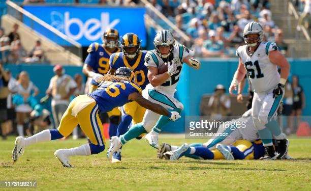 Marqui Christian of the Los Angeles Rams tackles Christian McCaffrey of the Carolina Panthers during the fourth quarter of their game at Bank of...