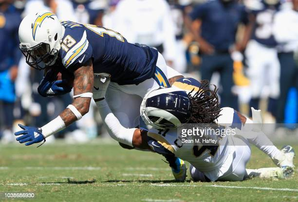 Marqui Christian of the Los Angeles Rams tackles Keenan Allen of the Los Angeles Chargers during the second quarter of the game at Los Angeles...