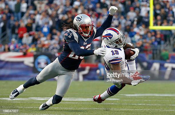 Marquice Cole of the New England Patriots stops Donald Jones of the Buffalo Bills who was injured on the play in the second half at Gillette Stadium...