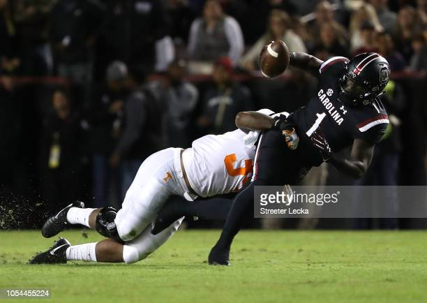 Marquill Osborne of the Tennessee Volunteers tackles Deebo Samuel of the South Carolina Gamecocks during their game at WilliamsBrice Stadium on...