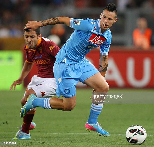 Marquinho of AS Roma competes for the ball with Marek Hamsik of SSC Napoli during the Serie A match between AS Roma and SSC Napoli at Stadio Olimpico...
