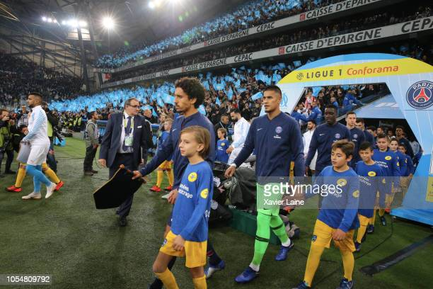 Marquinhos and Alphonse Areola of Paris SaintGermain enter the field before the French Ligue 1 match between Olympique Marseille and Paris...