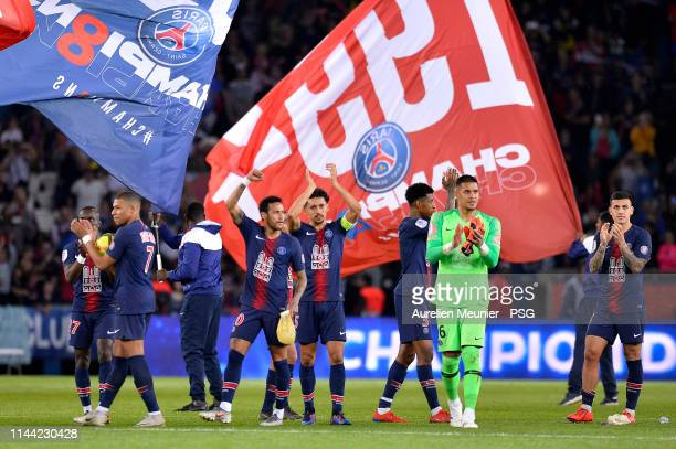 Marquinhos and Neymar Jr of Paris SaintGermain celebrate after winning the French Championship title after the Ligue 1 match between Paris...