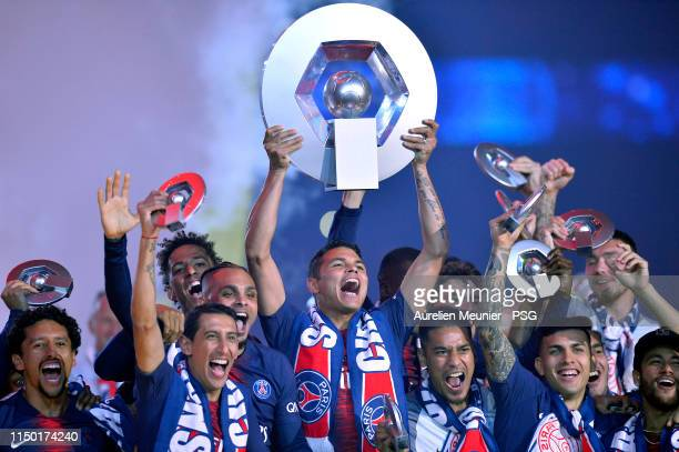 Marquinhos, Angel Di Maria, Layvin Kurzawa, Thiago Silva, Alphonse Areola, Leandro Paredes and Neymar Jr of Paris Saint-Germain react as they receive...