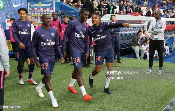 Marquinhos Moussa Diaby Stanley Nsoky and Christopher Nkunku of Paris SaintGermain enter the field before the French Ligue 1 match between Paris...