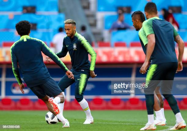 Marquinhos Neymar Paulinho and Renato Augusto in action during a Brazil training session and press conference ahead of the Group E match against...
