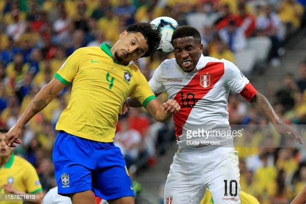 Marquinhos of Brazil and Jefferson Farfan of Peru jump to head the ball during the Copa America Brazil 2019 group A match between Peru and Brazil at...
