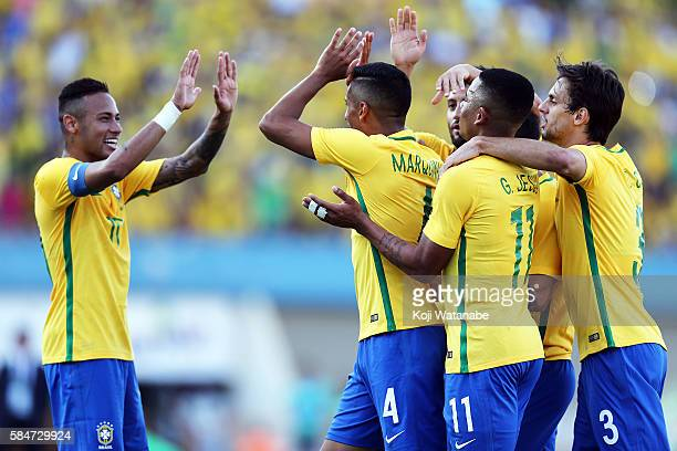 Marquinhos of Brazil celebrates scoring his team's second goal with team metes during the international friendly match between Japan and Brazil at...