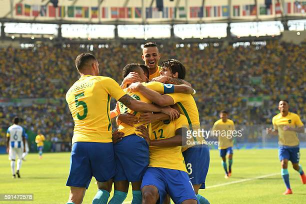 Marquinhos of Brazil celebrates scoring the 4th goal during with teammates during the Men's Semifinal Football match at Maracana Stadium on Day 12 of...