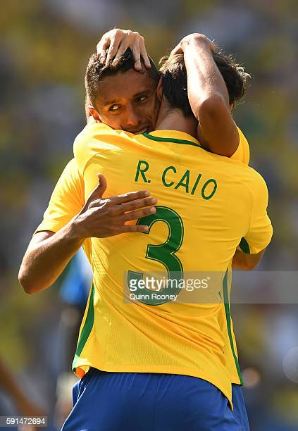 Marquinhos of Brazil celebrates scoring the 4th goal with Rodrigo Caio of Brazil during the Men's Semifinal Football match at Maracana Stadium on Day...