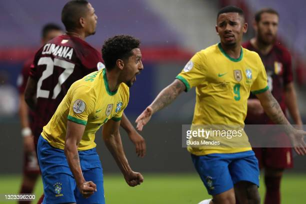 Marquinhos of Brazil celebrates with teammate Gabriel Jesus after scoring the first goal of his team during a Group B match between Brazil and...