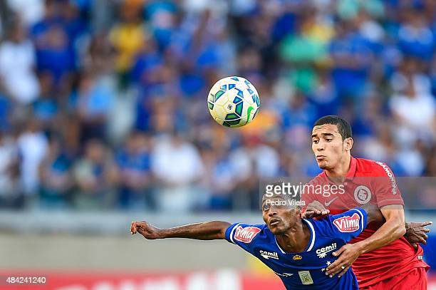 Marquinhos of Cruzeiro and William of Internacional battle for the ball during a match between Cruzeiro and Internacional as part of Brasileirao...