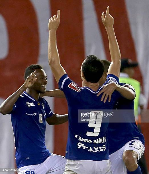 Marquinhos of Cruzeiro celebrates with his teammates after scoring the first goal of his team during a first leg match between River Plate and...