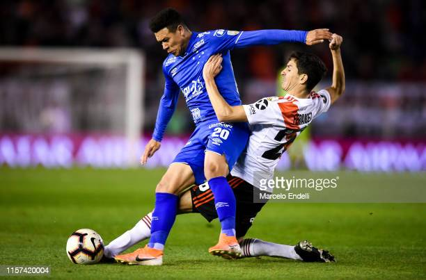 Marquinhos of Cruzeiro fights for the ball with Ignacio Fernandez of River Plate during a round of sixteen first leg match between River Plate and...