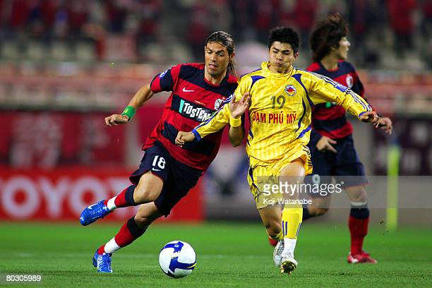 Marquinhos of Kashima Antlers and Nguyen Quang The of Dam Phu My Nam Dinh in action during AFC Champions League match between Kashima Antlers and Dam...
