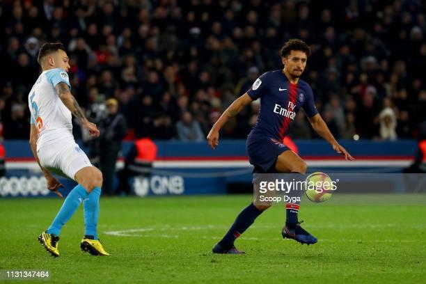 Marquinhos of Paris Saint Germain and Lucas Ocampos of Olympique de Marseille during the Ligue 1 match between Paris Saint Germain and Marseille at...