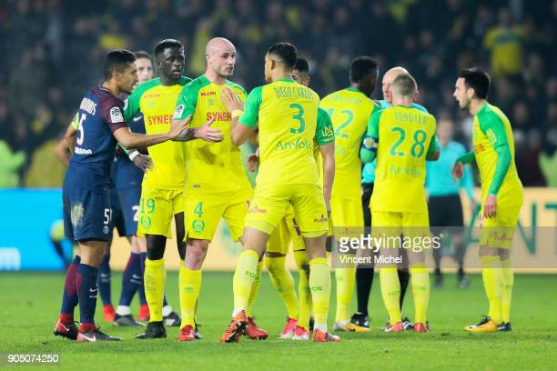 Marquinhos of Paris Saint Germain Nicolas Pallois Diego Carlos of Nantes and Tony Chapron referee during the Ligue 1 match between FC Nantes and...