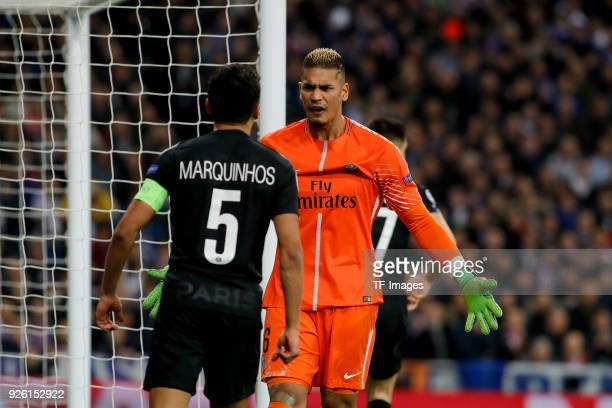 Marquinhos of Paris SaintGermain and Goalkeeper Alphonse Areola of Paris SaintGermain react during the UEFA Champions League Round of 16 First Leg...
