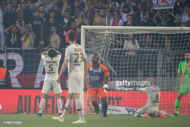 Marquinhos of Paris SaintGermain and Leandro Paredes of Paris SaintGermain react after a defensive error led to Souleymane Camara of Montpellier...