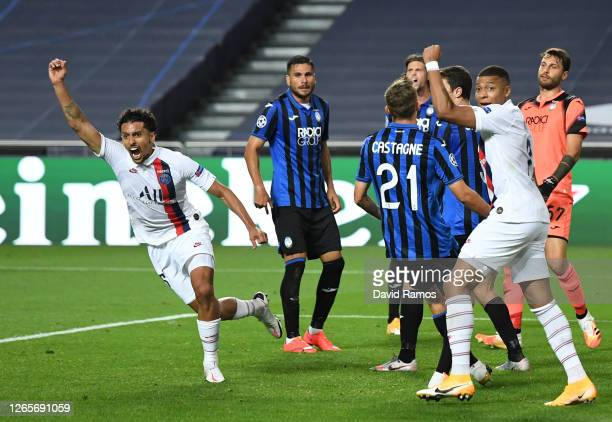 Marquinhos of Paris Saint-Germain celebrates after scoring his team's first goal during the UEFA Champions League Quarter Final match between...