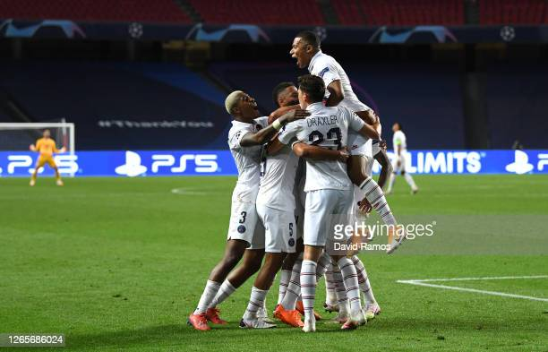Marquinhos of Paris SaintGermain celebrates with his team mates after scoring his team's first goal during the UEFA Champions League Quarter Final...