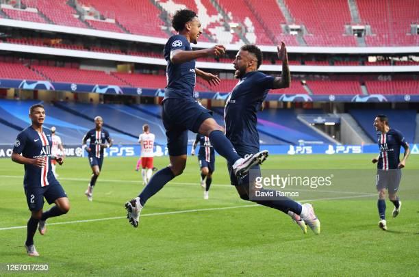 Marquinhos of Paris Saint-Germain celebrates with Neymar of Paris Saint-Germain after scoring his team's first goal during the UEFA Champions League...