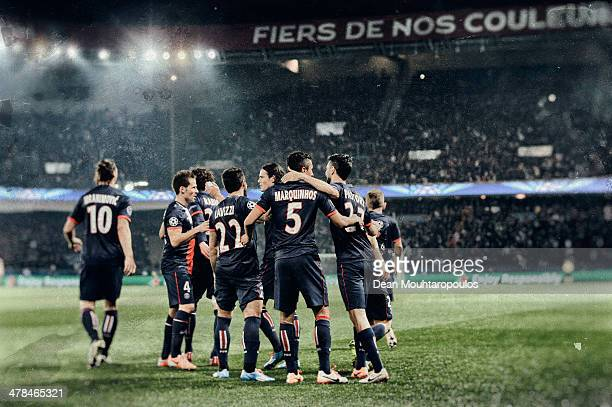Marquinhos of Paris Saint-Germain celebrates with team mates as he scores their first goal during the UEFA Champions League Round of 16 second leg...
