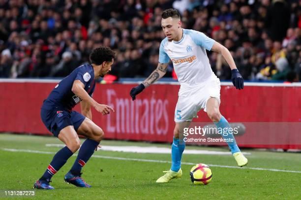 Marquinhos of Paris SaintGermain challenges Lucas Ocampos of Olympique de Marseille during the Ligue 1 match between Paris SaintGermain and Olympique...