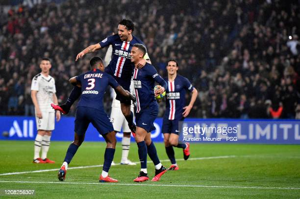 Marquinhos of Paris Saint-Germain is congratulated by teammates Thilo Kehrer and Presnel Kimpembe after scoring during the Ligue 1 match between...