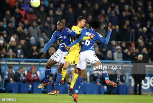 Marquinhos of Paris SaintGermain is slash by Ernest Seka and Bakary Kone of Strasbourg during the Ligue 1 match between Strasbourg and Paris Saint...