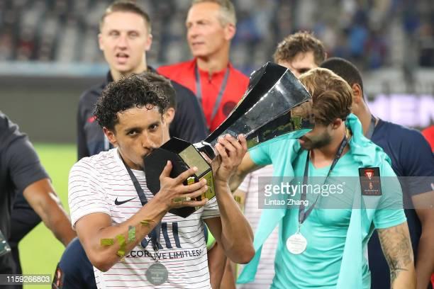 Marquinhos of Paris SaintGermain kiss the trophy celebrates after win the 2019 Trophee des Champions between Paris saintGermain and Stade Rennais FC...