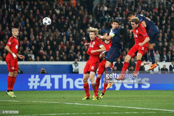 Marquinhos of Paris SaintGermain scores their first goal with a header during the UEFA Champions League Round of 16 second leg match between Paris...