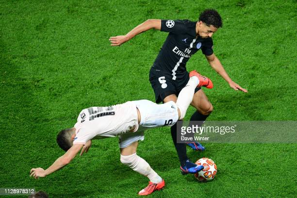 Marquinhos of PSG and Andreas Pereira of Man Utd during the UEFA Champions League Round of 16 Second Leg match between Paris Saint Germain and...