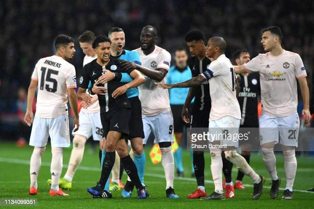 Marquinhos of PSG and Ashley Young of Manchester United clash during the UEFA Champions League Round of 16 Second Leg match between Paris...