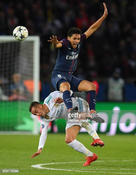 Marquinhos of PSG and Lucas Vazquez of Real Madrid battle for the ball during the UEFA Champions League Round of 16 Second Leg match between Paris...