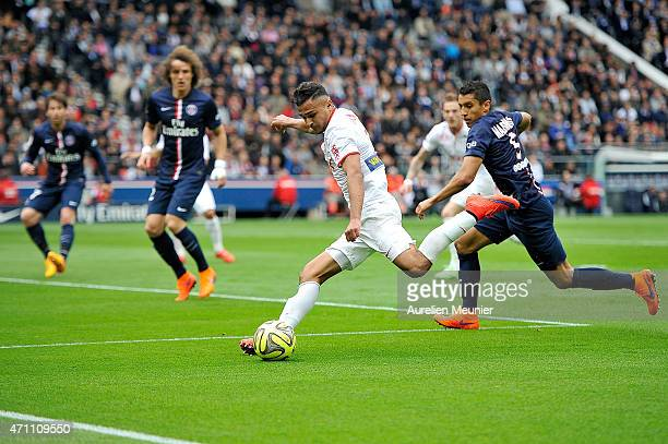 Marquinhos of PSG and Sofiane Boufal of Llosc Lille in action during the Ligue 1 game between Paris Saint Germain and Llosc Lille at Parc des Princes...