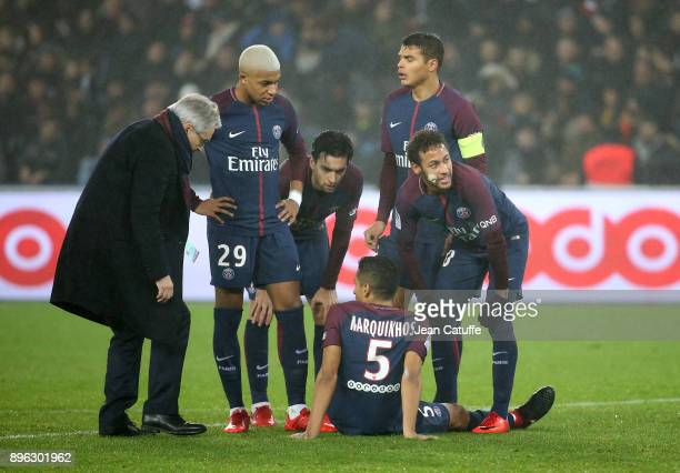 Marquinhos of PSG is injured while PSG doctor Eric Rolland Kylian Mbappe Javier Pastore Thiago Silva Neymar Jr look on during the French Ligue 1...