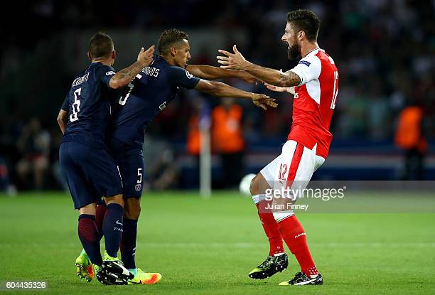 Marquinhos of PSG pushes Olivier Giroud of Arsenal during the UEFA Champions League Group A match between Paris SaintGermain and Arsenal FC at Parc...
