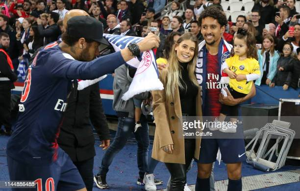 Marquinhos of PSG with his wife Carol Cabrino and their daughter Maria Correa are disturbed by Neymar Jr of PSG while celebrating winning the 'French...