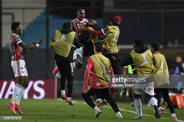 Marquinhos of Sao Paulo celebrates with teammates after scoring the second goal of his team during a round of sixteen second leg match between Racing...