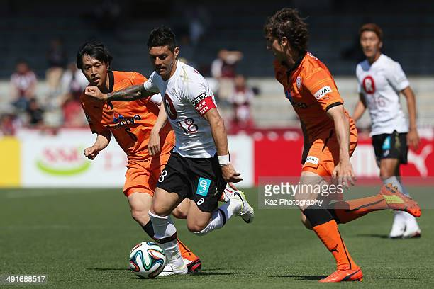 Marquinhos of Vissel Kobe competes for the ball against Kota Sugiyama and Dejan Jakovic of Shimizu SPulse during the JLeague match between Shimizu...