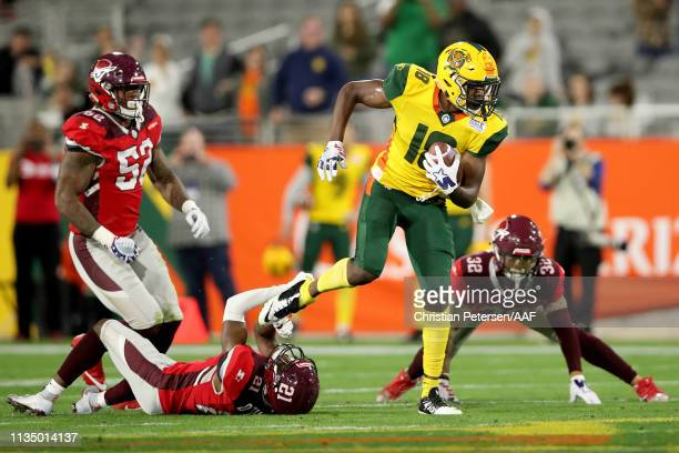 Marquis Bundy of the Arizona Hotshots runs with the ball while being tackled by Duke Thomas of the San Antonio Commanders in the fourth quarter...
