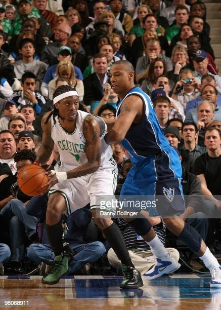 Marquis Daniels of the Boston Celtics handles the ball against Caron Butler of the Dallas Mavericks during the game on March 20 2010 at American...
