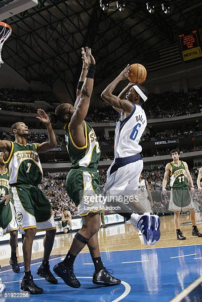 Marquis Daniels of the Dallas Mavericks attempts to shoot against Danny Fortson of the Seattle Supersonics during the game at the American Airlines...