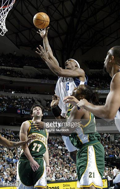Marquis Daniels of the Dallas Mavericks goes up for a layup over Danny Fortson of the Seattle Supersonics December 9 2004 at the American Airlines...