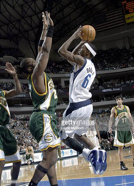 Marquis Daniels of the Dallas Mavericks shoots over Danny Fortson of the Seattle Supersonics December 9 2004 at the American Airlines Center in...